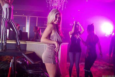 Blonde stripper Eva Parcker giving head to big cock in strip club