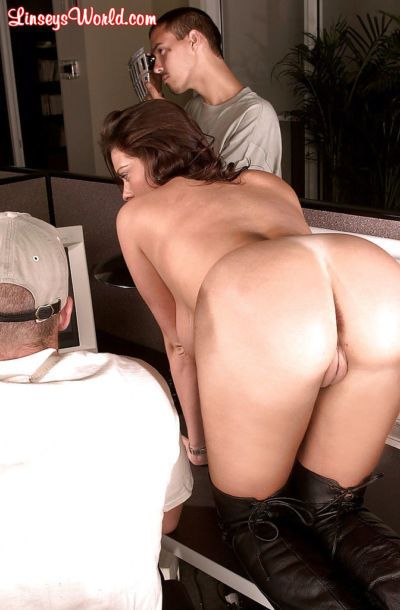 MILF Linsey Dawn McKenzie performing striptease at office party in long boots - part 2