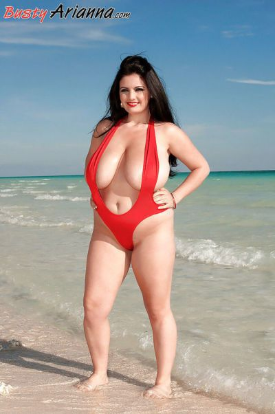 Chubby Arianna Sinn modeling in red bikini and exposing ripe boobs outdoor