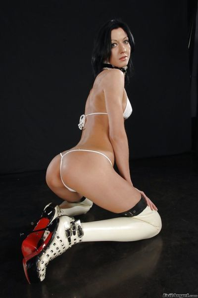 Skinny brunette in latex high heeled boots slipping off her bikini - part 2